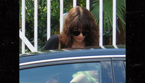 Asia Argento Seen Leaving Home Day After Anthony Bourdain's Suicide