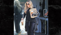 Khloe Kardashian Looks Over The Moon Leaving Kanye's Office