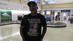 Evander Holyfield Wears Shirts Quoting Himself
