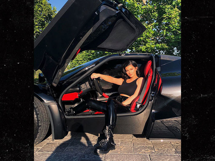 Kylie Jenner is back in black ... and looking fine in front of a sports car.