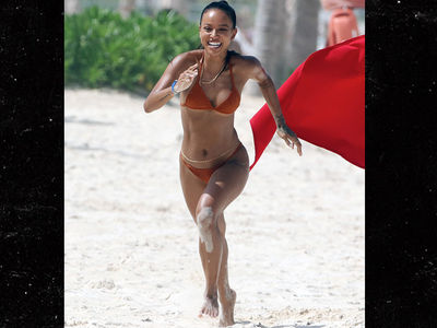 Karrueche Tran Bikini Racing in Cancun