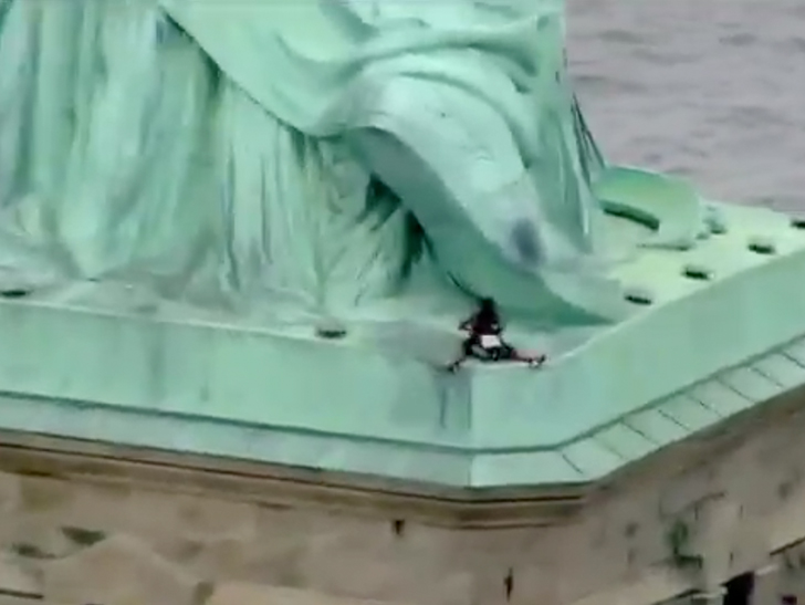 Statue of Liberty climber due in court after immigration protest