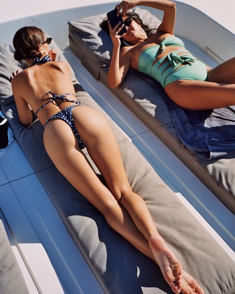 Emily Ratajkowski soaking in the summer sun.