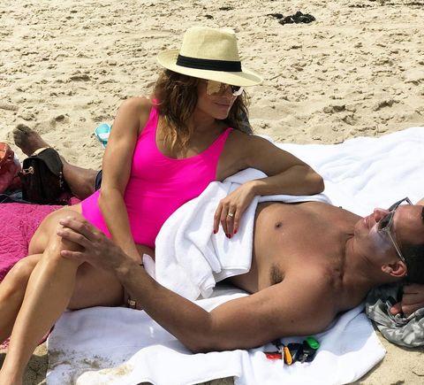 Jennifer Lopez enjoys a day on the beach with Alex Rodriguez.