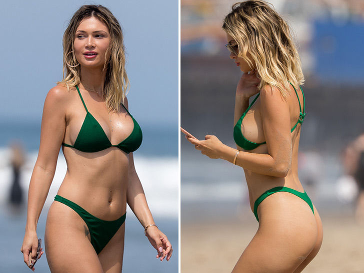 Ella Rose Cools Off In Green Bikini at Beach