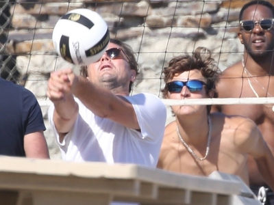 Leonardo DiCaprio Plays Beach Volleyball With Ansel Elgort