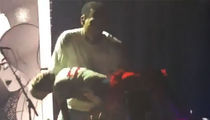 Chris Brown Catches Fainting Kid Onstage