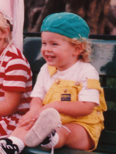 Before this curly-haired cutie was a true showman, he was just another kid rockin' some colorful clothes in San Luis Obispo, CA