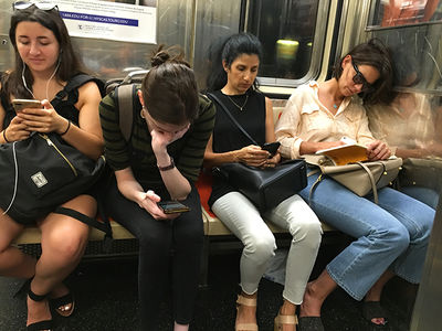 Katie Holmes Blends in with New Yorkers on Subway