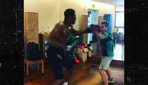 Giannis Antetokounmpo Takes 'Freaky' Boxing Lesson With Guy Half His Size