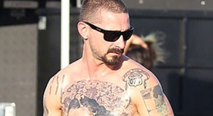Shia LaBeouf Looks Unrecognizable As He Puts His Shirtless, Tattooed Body on Display on Set