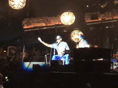 Dennis Rodman Crashes Pearl Jam Set at Wrigley Field to Talk North Korea