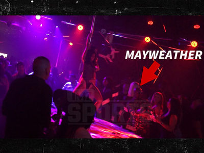 Floyd Mayweather Throws $50k From His Backpack at Strip Club