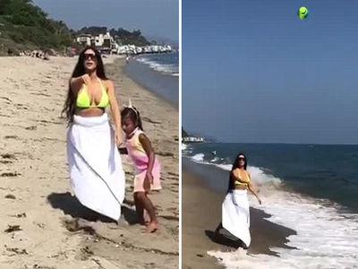 Kim Kardashian Strolls Malibu Beach in Bikini