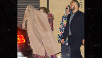 Adele Covers Her Face as She Leaves Malibu Restaurant