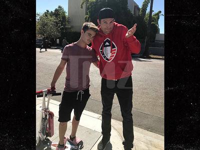 Ashton Kutcher's Car Hits Manny on a Scooter