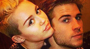 Miley Cyrus Poses With Baby In New Pic After It's Revealed She & Liam Hemsworth Have 'Hot…