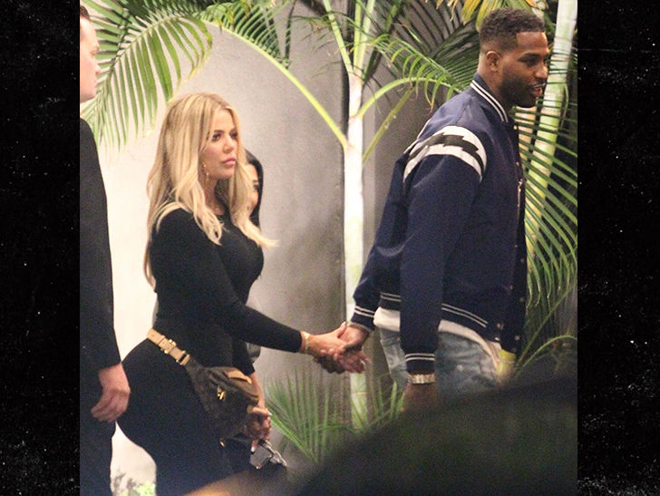 Khloe Kardashian and Tristan Thompson hold hands at birthday party amid cheating rumors.