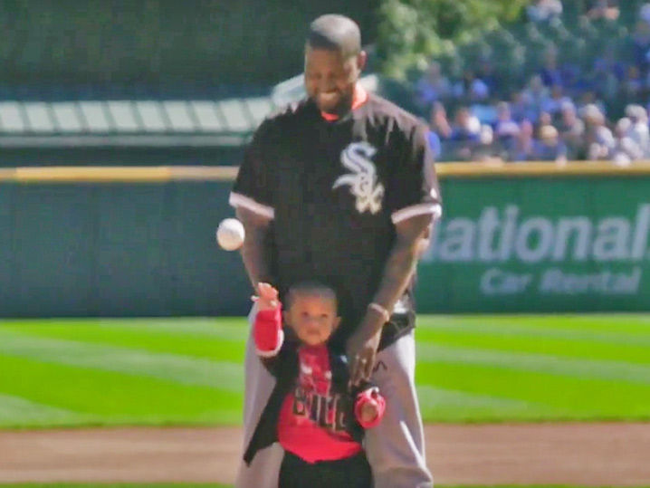 Kanye and Saint throw out the first pitch at the Cubs-White Sox game.