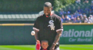 Kanye West and Saint Throw First Pitch at Chicago Cubs-White Sox Game