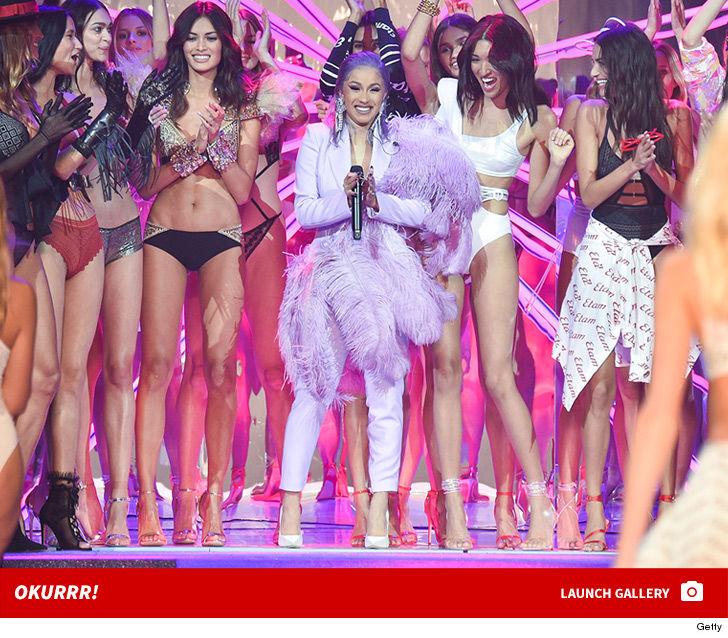 0926 cardi b etam fashion show paris photos launch 3 - Cardi B Flaunts Feathers at Etam Show for Paris Fashion Week