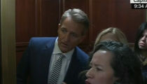 Sen. Jeff Flake Cornered by Protesters After Decision to Confirm Brett Kavanaugh
