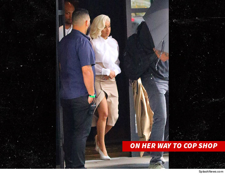 Cardi B turns herself in to police, charged with endangerment and assault