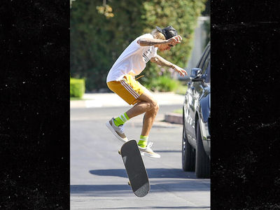 Justin Bieber Skateboarding Through New Neighborhood