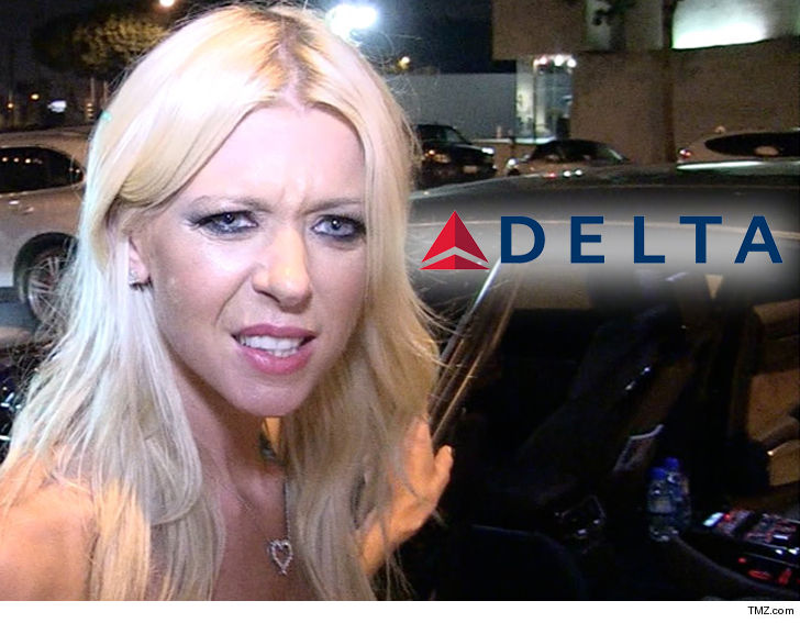 Tara Reid Says Delta Airlines Wanted Her Dog Put in Overhead Bin