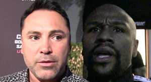 Oscar De La Hoya Claps Back at Mayweather, 'We Don't Hit Women'