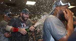 Watch Red Sox Pop Bottles, Crush Beers To Celebrate World Series Berth