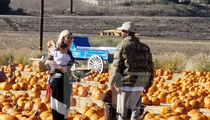Kylie Jenner & Travis Scott Spend Day with Stormi at Pumpkin Patch
