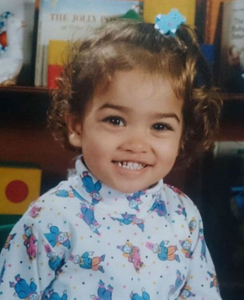 Before this sweet smile was lighting up the Victoria's Secret runway, this happy human was just another bundle of joy growing up in Melbourne, Australia