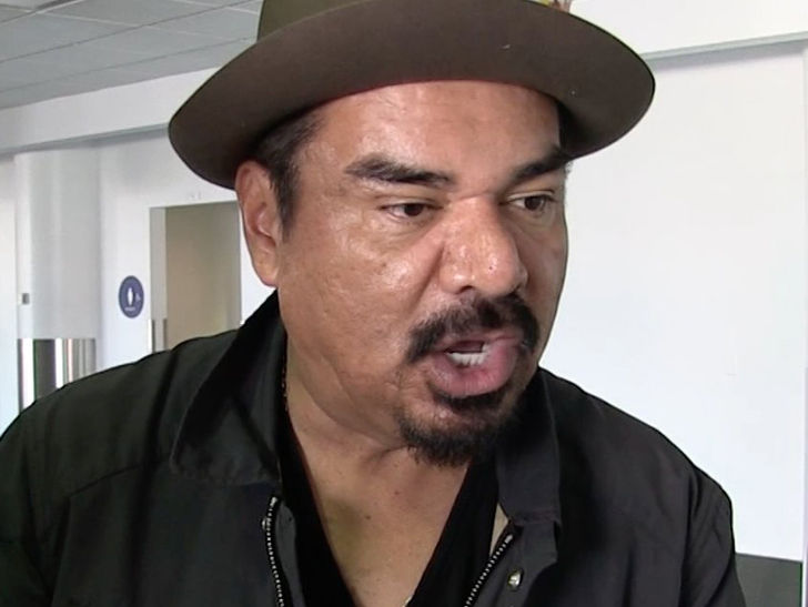 George Lopez charged in Hooters dust-up.