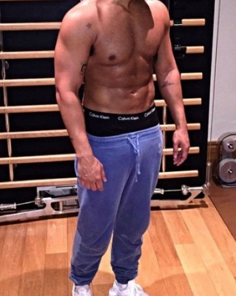 Guess the shirtless stud chillin' in his sweatpants!