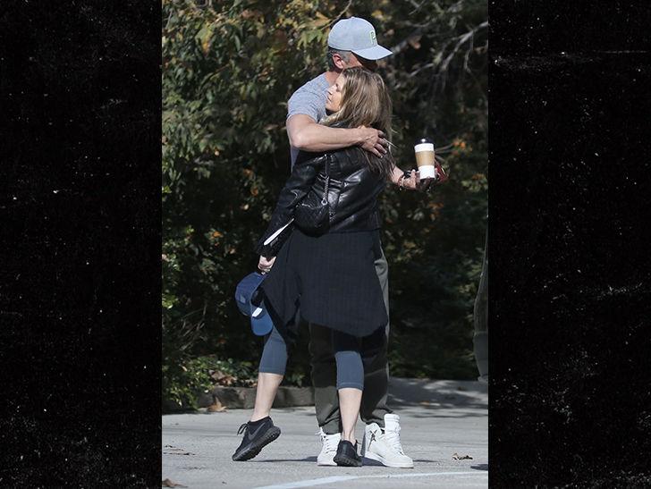Fergie and Josh Duhamel share a warm embrace despite separation and possible divorce.