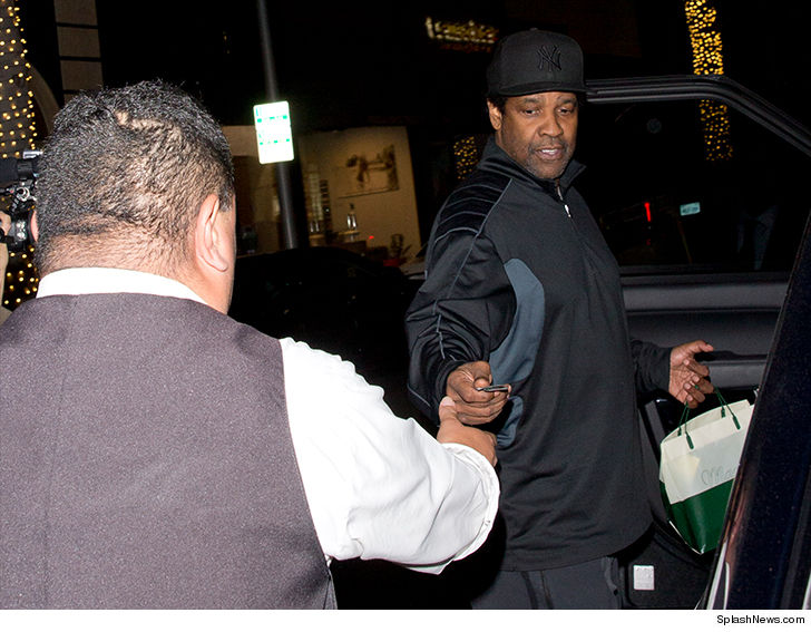 Denzel Washington gets in the holiday spirit tipping valet guy huge dough.