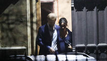 Meghan Markle's Baby Bump Front & Center on Night Out with Prince Harry