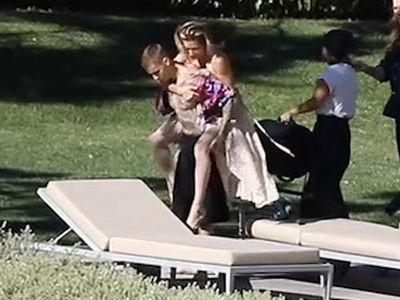 Justin Bieber Gives Wife Hailey a Shirtless Piggyback Ride for Photo Shoot