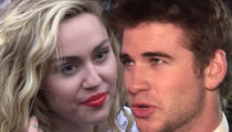 Miley Cyrus and Liam Hemsworth Appear to Be Married