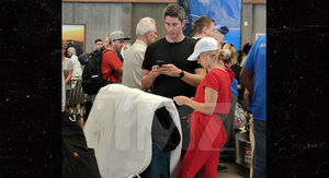 'Bachelor' Couple Arie and Lauren Spotted at Airport with Wedding Dress in Hand