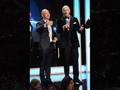 Jeff Bezos Makes First Public Appearance with John Travolta at Living Legends of Aviation Awards