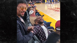Floyd and Manny Have Painfully Awkward Handshake at Lakers Game