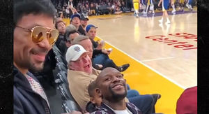 Floyd Mayweather and Manny Pacquiao Have Awkward Handshake at Lakers Game