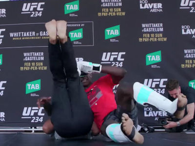 UFC's Israel Adesanya Busts Out Stone Cold Stunner and The Rock's People's Elbow!