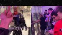 Travis Scott Fans Freak Out Over Postponed Show, Shatter Glass Door