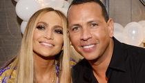 Jennifer Lopez and Alex Rodriguez Engaged, Celebrate on Bed of Roses