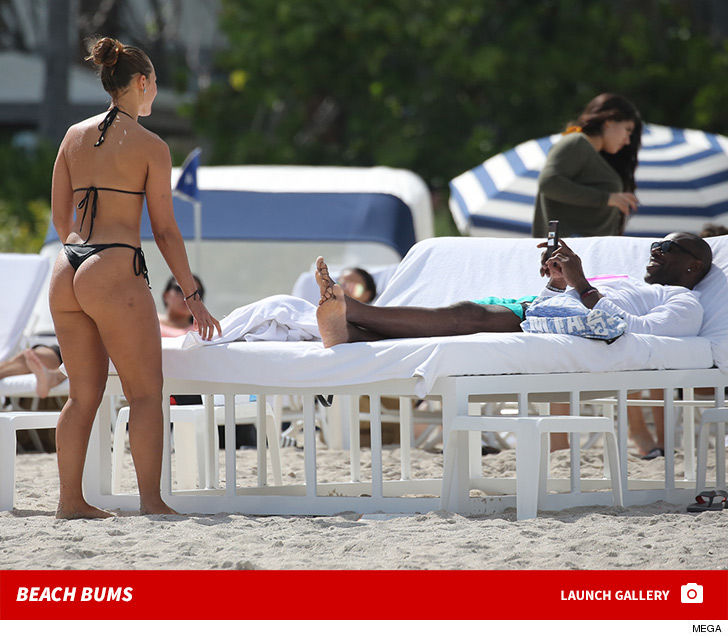 Terrell Owens Say Cheeks!!! Snaps Pics For Mystery Beach Babe in Thong