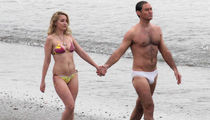 Jude Law Strips Down to Speedo, Gets Handsy with 'New Pope' Costar