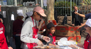 Pharrell Williams and Son Help Feed Homeless on Good Friday